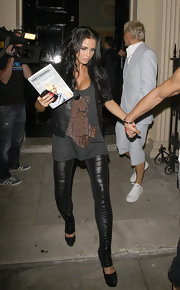 Katie rocked a rhinestone teddy bear top with skintight leather leggings.