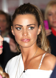 Katie Price kept her look casual at the Professional Beauty Show in London by wearing her long hair in a high ponytail.
