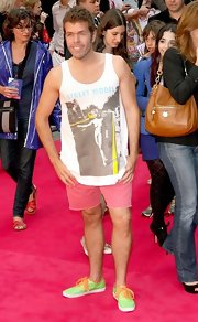 A tank top and pink shorts seem more appropriate for the beach than the red carpet, but that's Perez Hilton for you!
