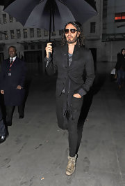 To top off his all black look, Russell Brand chose a plaid patterned blazer.