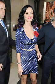 Katy Perry showed off her shoulder length curls, which were highlighted with subtle rainbow colors.