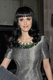 Katy Perry made an appearance a Radio One studios with long raven curls and blunt cut bangs.