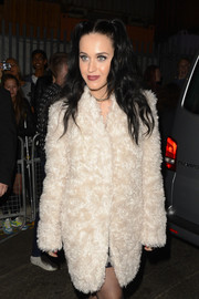 Katy Perry showed off her quirky style in London with her pale pink fur coat and pigtails.