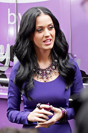 While promoting her new fragrance Purry in New York, Katy paired her long sleeve cocktail dress with a gemstone statement neckalce.