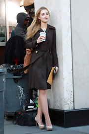 Ella Rae Peck was on set, shooting a scene for 'Gossip Girl' and wearing a pair of chic beige platform pumps.