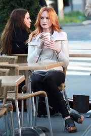 Kaylee Defer wore a pair of black leather peep toe shoes with wooden wedges while shooting a scene for 'Gossip Girl.'