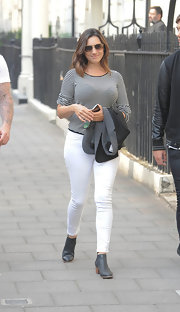 Kelly paired white skinny pants with her striped top while out in London.