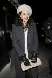 Kelly channels Old Hollywood glamour in fur cap and wool coat.