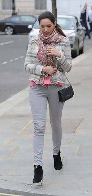 Kelly opted for a colored jean for her street style look in London.
