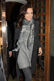 Kelly wore a worn in abstract print scarf for this winter style.