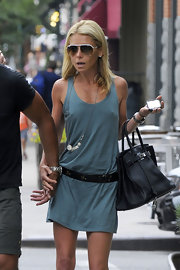 Kelly Ripa paired her green tank dress with the classic Birkin bag.