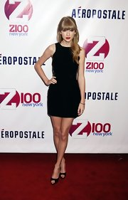 Taylor Swift made an entrance at Z100's 2012 Jingle Ball in black Jimmy Choo peep-toe pumps.