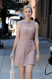 Kelly looked simply lovely on her walk wearing this blush day dress with lace detailing and a sheer dotted panel.