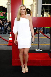 Lindsey Vonn modernized her white asymmetrical dress with nude patent peep-toe booties.