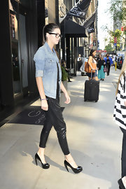 Kendall Jenner hit the NYC streets rocking a pair of shiny black harem pants and towering stilettos.