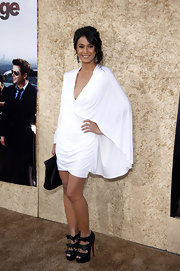 Emmanuelle was beautiful in a flowing white cocktail dress with a plunging necklines and unique draping.