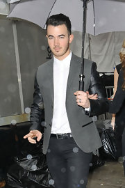 Kevin Jonas showed his classic side and his edgy side with this gray blazer with leather sleeves.