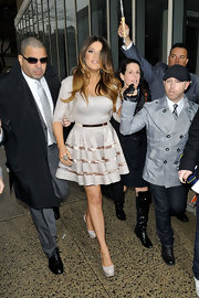 Khloe topped off her fit-and-flare frock with gray platform pumps.