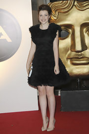 Georgie looks so sweet in this black textured cocktail dress at The British Academy Children's Awards in London.