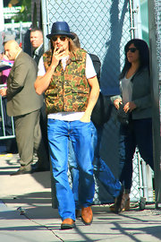Kid Rock may be the only one who could pull off a camouflage puffer vest.