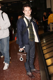 Elijah Wood spotted in a casual ensemble and a pair of brown oxfords at the Sundance Film Fest.