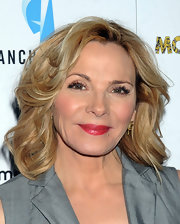 Kim Cattrall styled her shoulder length hair in loose curls for the premiere of 'Meet Monica Velour.'