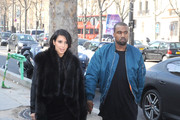Kim Kardashian and Kanye West are seen walking together at 'Palais de Tokyo' in Paris.