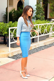 Kim Kardashian finished off her light blue separates with white pointy-toe pumps.