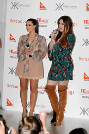 Khloe Kardashian donned statement boots at the Kardashian Kollection event in Sydney. She paired her printed mini dress with cognac-colored lace-up boots.