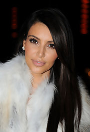 Kim Kardashian attended the Kanye West fall 2012 runway show wearing a pale pink lipstick topped with gloss.
