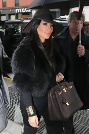 Kim kept warm in NYC while filming scenes for her knew show, 'Kim and Kourtney take New York'.