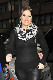 Khloe wears a black and white animal print scarf while out in New York with her sisters.