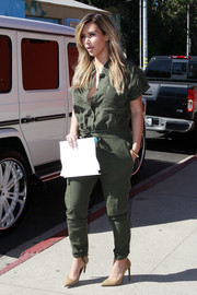 Kim Kardashian was military-chic in a green jumpsuit while out on a lunch date.