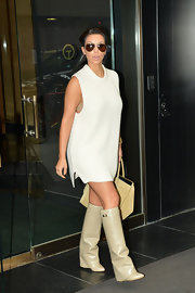 Kim wore this bra-revealing sweater tunic with her knee-high boots out in NYC.