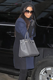 While doing some filming in New York, Kim showed off one of her many Birkin bags.