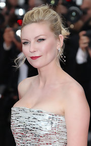 Kirsten Dunst added a classic splash of color to her evening look with matte red lipstick.