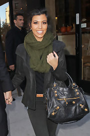Kourtney stayed warm while hitting the streets of NYC. The reality star completed her leather jacket with a moss green scarf.