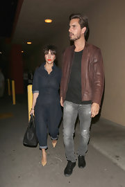 Kourtney Kardashian chose this retro-inspired denim jumpsuit for her cool look while out with Scott Disick.