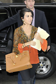 Kourtney Kardashian was effortlessly chic while out and about in NYC in her classic tan Birkin.