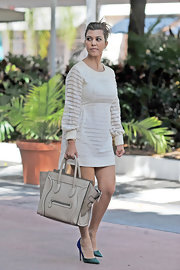 Kourtney Kardashian left the top of her look light with this taupe Celine tote.