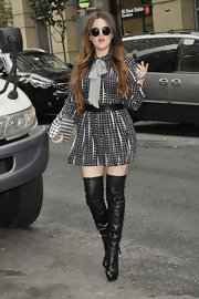 Khloe paired her patterned ensemble with black leather over-the-knee boots.