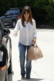 Classic straight-leg jeans kept Kourtney Kardashian's daytime look casual and relaxed.