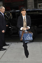 Kris Jenner stepped out in NYC wearing a polished pinstripe suit with a playful leopard print tie.