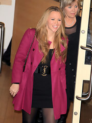 Kimberley Walsh covered up in feminine style with a fuchsia swing jacket as she left the Fountain Studios.