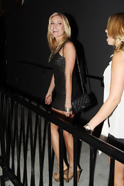 On another crazy night out Kristen Cavallari made a leggy appearance in this black mini dress and nude peep-toe heels. She completed her look with a chain strap shoulder bag.