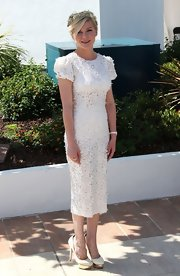 Kirsten Dunst arrived at a photocall for 'On the Road' wearing a lacy white day dress with puff sleeves.