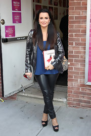 Kyle Richards added festive sparkle to her street attire with a sequined gunmetal blazer.