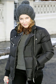 Kylie is always bundled for winter. Here the Kylie dons a warm pom pom beanie in London.