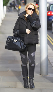 Kylie Minogue added wow factor to her monochromatic street wear with a black Rosalie Gloss Snake tote.