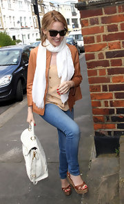 Kylie Minogue headed out in London wearing a pair of chunky brown wedges that complemented her buttery leather jacket.